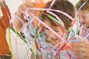 Boy covered in streamers